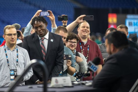 Ohio State defensive end Zach Harrison asks head coach Ryan Day a question during day two of Big Ten Media Days at Lucas Oil Stadium in Indianapolis, Indiana, on Friday, July 23. Day joked they may let Harrison play tight end in a goal line set.