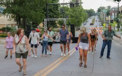 Line dancers move to the music in front of the Washington Street stage during the Block Party in Iowa City on Saturday, July 24.