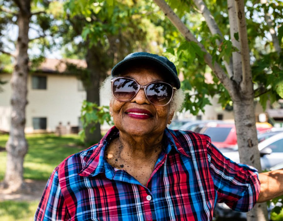 Portia Byrd of Iowa City poses for a portrait while watching the 4th Fest parade on Sunday, July, 4, 2021. This is Byrds 1st 4th Fest parade. Byrd is originally from Florida she moved to Iowa City to be by her son.
