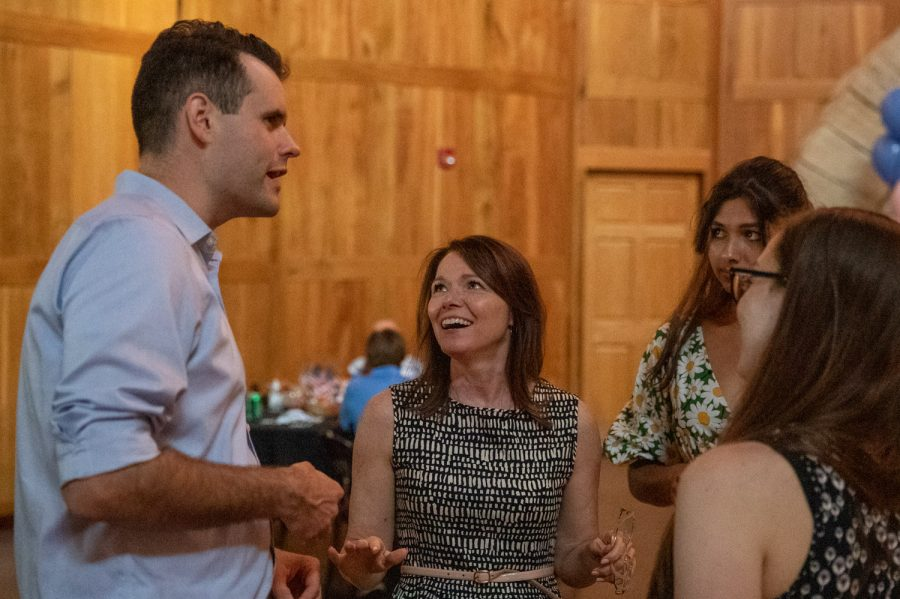 Iowa Senate Minority Leader Zach Wahls chats with Iowa House Rep. Christina Bohannon during Bohannon's birthday celebration in Iowa City on Friday, July 2, 2021.  (Jerod Ringwald/The Daily Iowan)