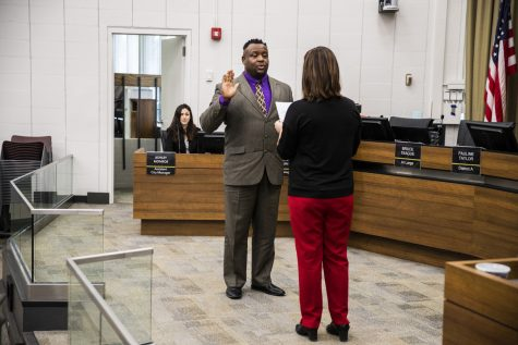 Mayor Bruce Teague is sworn in during the City Council meeting at Iowa City City Hall on Thursday, January 2, 2020. The city councilors also voted on appointments for a number of city commissions.