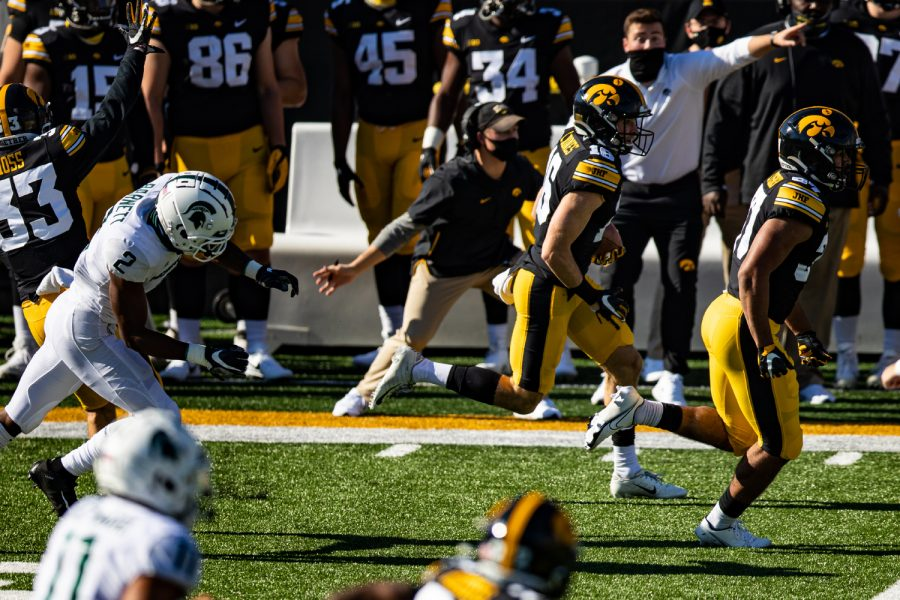 Iowa wideout Charlie Jones returns a punt during a football game between Iowa and Michigan State in Kinnick Stadium on Saturday, Nov. 7, 2020. The Hawkeyes dominated the Spartans, 49-7.