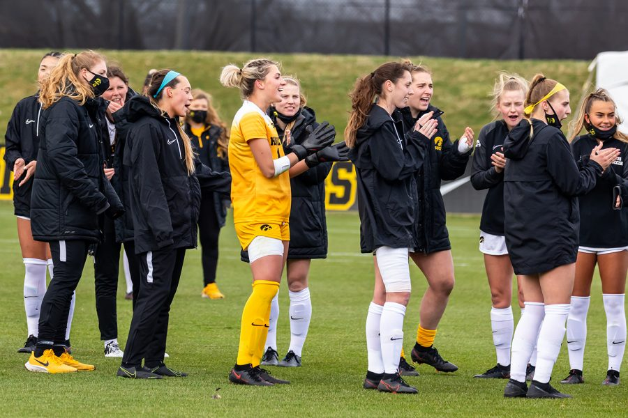 The Iowa soccer team cheers for their teammates during the senior day celebration before the start of the Iowa Soccer senior day game against Purdue on Mar. 28, 2021 at the Iowa Soccer Complex. Iowa defeated Purdue 1-0.