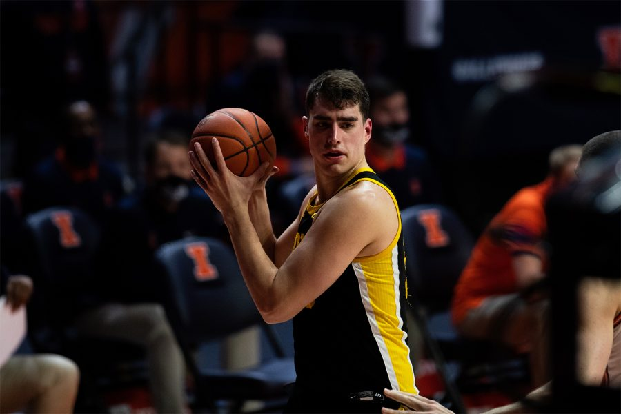 Iowa+Center+Luka+Garza+%2855%29+holds+the+ball+during+a+basketball+game+between+Illinois+and+Iowa+at+State+Farm+Center+on+Friday%2C+Jan.+29.+Illinois+defeated+Iowa+80-75.