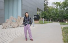 University of Iowa graduate student and filmmaker Hao Zhou stands outside of the Visual Arts Building on Thursday, July 22.