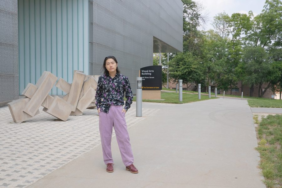 University+of+Iowa+graduate+student+and+filmmaker+Hao+Zhou+stands+outside+of+the+Visual+Arts+Building+on+Thursday%2C+July+22.