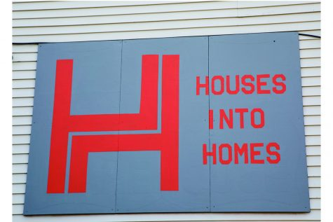 Houses Into Homes Sign as seen on Friday, July 2, 2021.