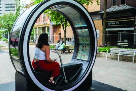 Jiselle Fernandez of Iowa City tries one of the loop devices on Friday, July, 7, 2021. Fernandez says she likes how they work and likes the music.