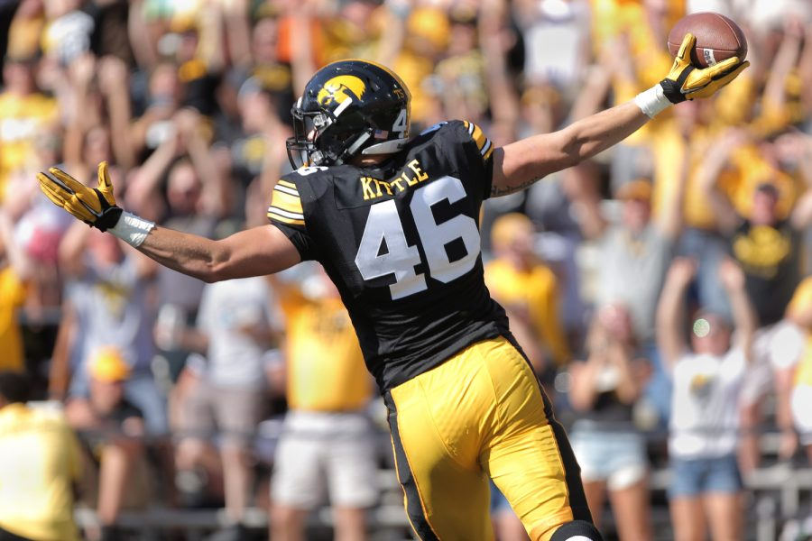Iowa tight end George Kittle celebrates after his touchdown during the Iowa-North Texas game in Kinnick Stadium on Saturday, Sept. 26, 2015. The Hawkeyes defeated the Mean Green, 62-16.