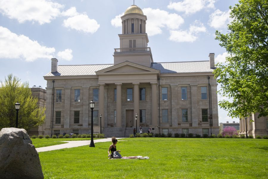 A student studies on the Pentacrest at the University of Iowa on Sunday, May 2, 2021.
