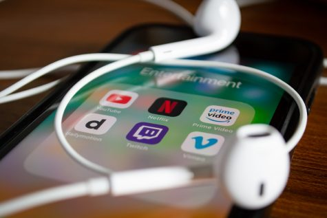 Bangkok, Thailand - June 10, 2019 : iPhone 7 showing its screen with Netflix and other video streaming applications.