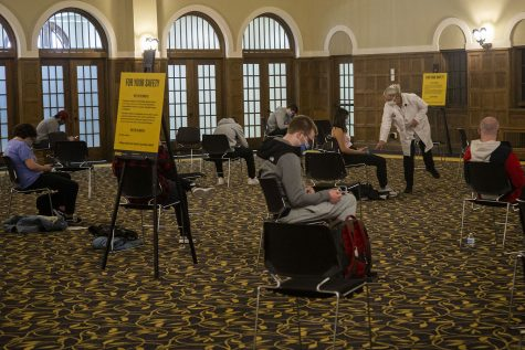 Students sit and wait for 15 to 30 minutes after receiving the COVID-19 vaccine in the Iowa Memorial Union at the University of Iowa on Wednesday, April 21, 2021.