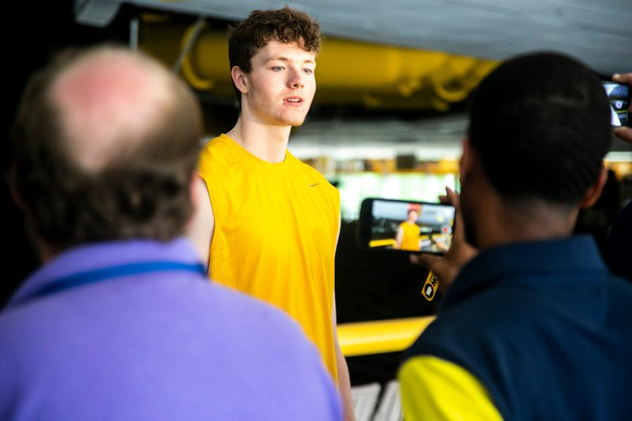 Iowa center Riley Mulvey speaks to reporters during a Hawkeyes men