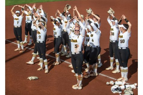 Iowa players lead a chant with fans after a softball game between Iowa and Nebraska on Sunday, May 9, 2021 at Bob Pearl Softball Field. The Hawkeyes defeated the Cornhuskers4-1.