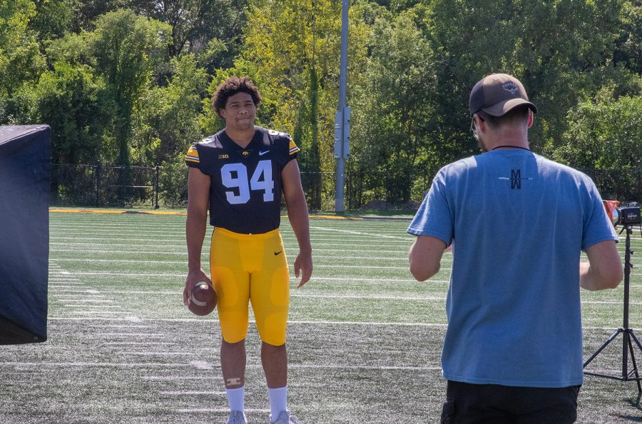 Iowa defensive lineman Yahya Black poses for a photographer during Iowa Football Media Day at Iowa footballs practice field on Friday, Aug. 13, 2021.