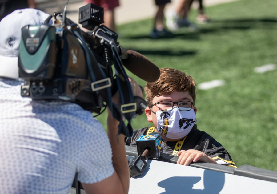 """Iowa kid captain Drew Hennigan answers questions during an interview with ABC during """"Kid's Day at Kinnick"""" inside Kinnick Stadium on Saturday, Aug. 14."""