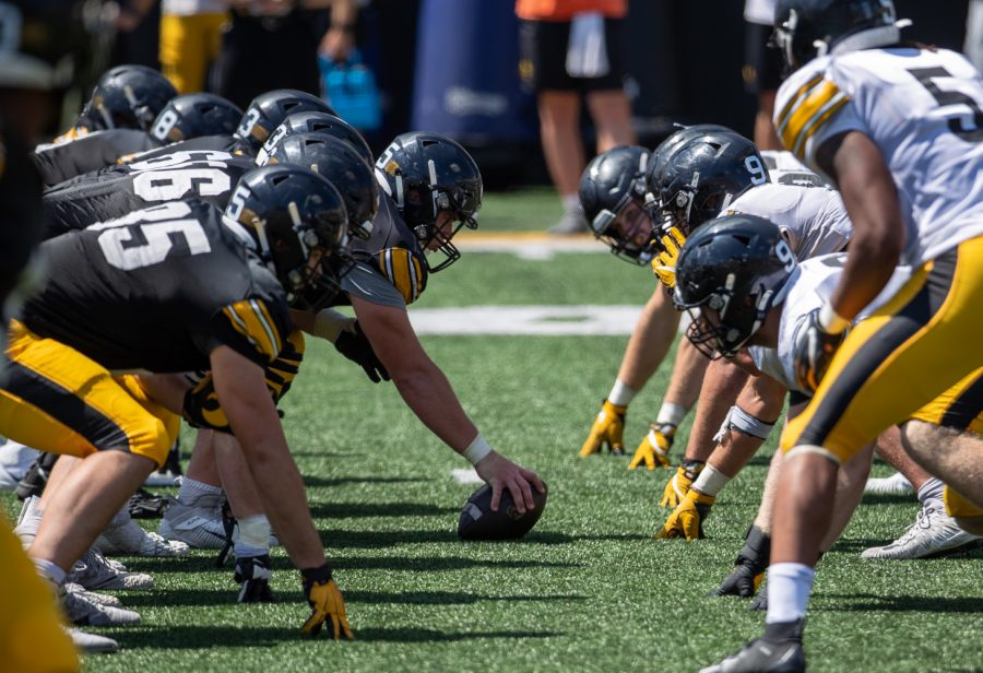 """Iowa center Tyler Linderbaum gets ready to snap the ball during """"Kid's Day at Kinnick"""" inside Kinnick Stadium on Saturday, Aug. 14."""