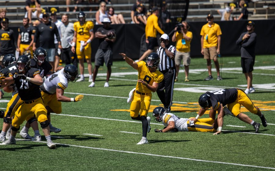 "Iowa quarterback Alex Padilla throws the football during ""Kid's Day at Kinnick"" inside Kinnick Stadium on Saturday, Aug. 14."