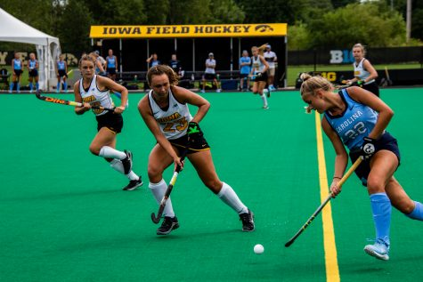 The Iowa Hawkeyes and the North Carolina Tar Heels fight for the ball during the Iowa field hockey game against North Carolina on Sunday, Aug. 29, 2021. The Hawkeyes defeated the Tar Heels 3-1.