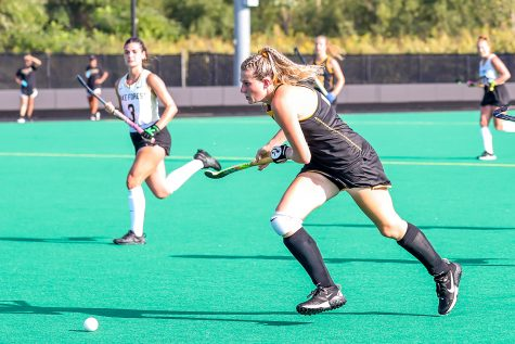 Iowa midfielder/forward Ellie Holley runs after the ball to gain possession during the Iowa Field Hockey Big Ten/ACC Challenge game against Wake Forest on Aug. 27, 2021 at Grant Field. Iowa defeated Wake Forest 5-3.