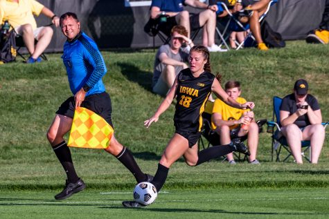 Iowa forward Courtney Powell goes to kick the ball during the Iowa Soccer Cy-Hawk Series game against Iowa State on Aug. 26, 2021 at the Iowa Soccer Complex. Iowa defeated Iowa State 2-1.