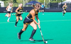 Iowa forward/midfielder Maddy Murphy runs down the field with the ball during the Iowa Field Hockey Big Ten/ACC Challenge game against Wake Forest on Aug. 27, 2021 at Grant Field. Iowa defeated Wake Forest 5-3.
