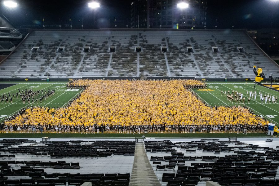 First-year students are seen taking a class of 2025 photo on Kinnick Stadium at Kickoff at Kinnick on Friday, Aug. 20, 2021.