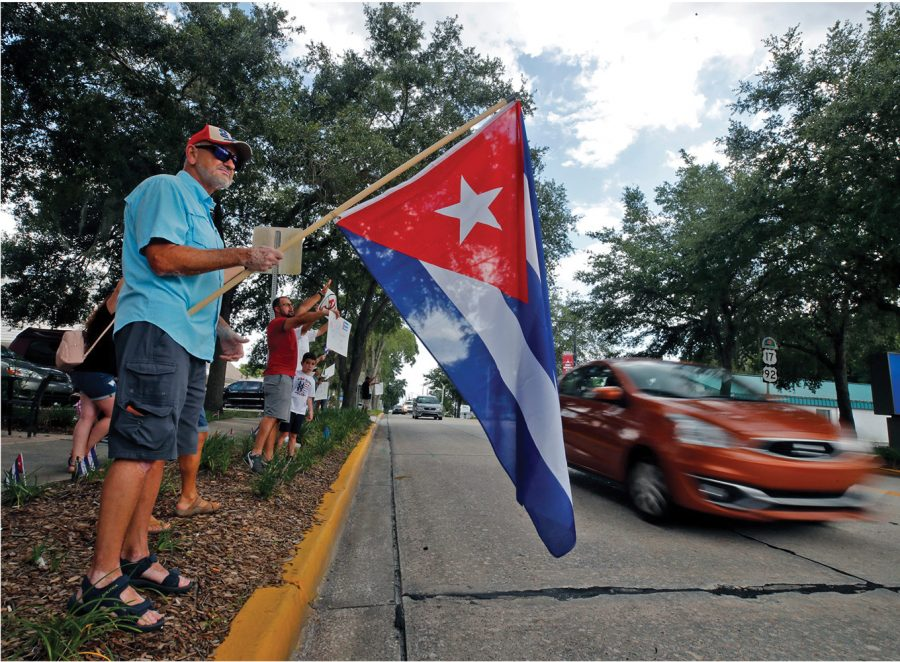 At the south end of downtown DeLand, outside of Chicas Cuban Cafe, about two dozen people gathered on Wednesday, July 21, to show their support for the people of Cuba who have been protesting against the government in unprecedented numbers this month.© Nigel Cook/News-Journal via Imagn Content Services, LLC