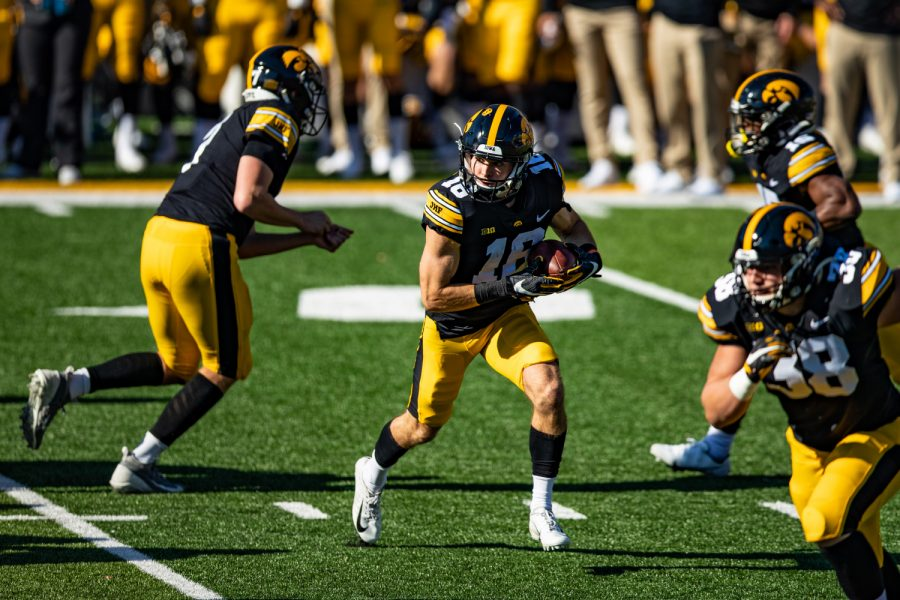 Iowa wideout Charlie Jones takes a handoff during a football game between Iowa and Michigan State in Kinnick Stadium on Saturday, Nov. 7, 2020. The Hawkeyes dominated the Spartans, 49-7.