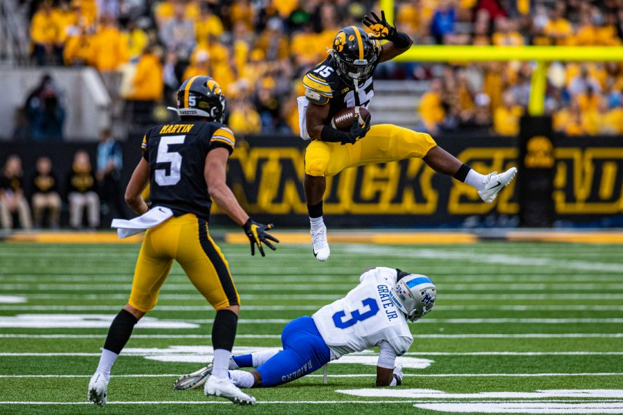 Iowa running back Tyler Goodson hurdles MTSUs Gregory Grate, Jr. during a football game between Iowa and Middle Tennessee State at Kinnick Stadium on Saturday, September 28, 2019. The Hawkeyes defeated the Blue Raiders, 48-3.
