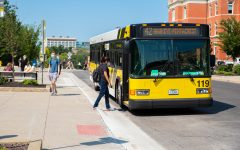 The Hawkeye-Pentacrest Cambus picks up a student at the Pentacrest on August 30, 2021