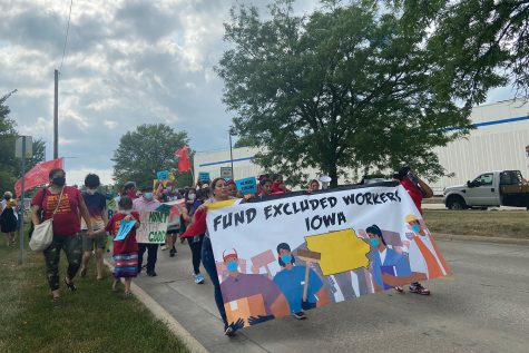 Demonstrators marched from the Iowa City Catholic Worker House to Mercer Park Wednesday afternoon.