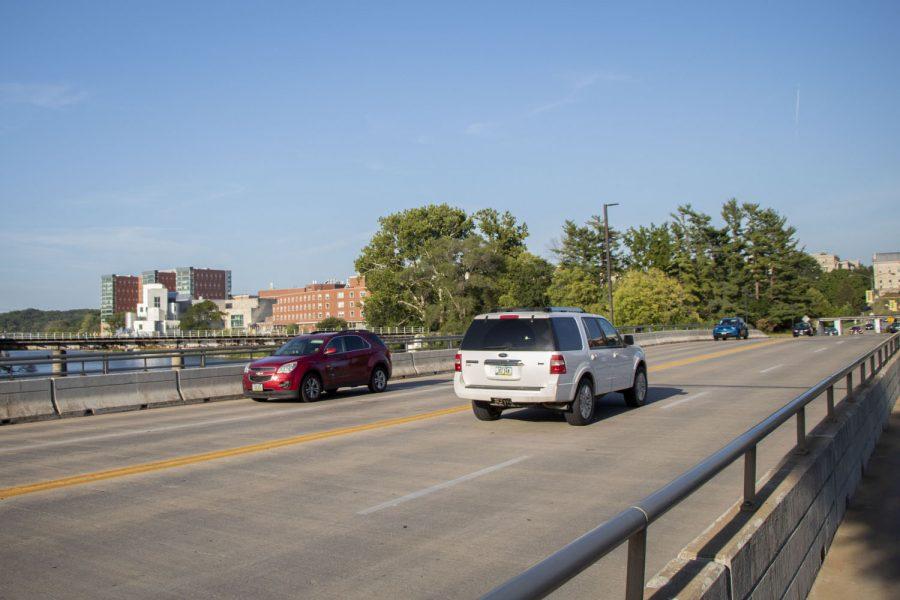 Cars drive across the Iowa Avenue bridge in Iowa City on Monday, Aug. 23, 2021.