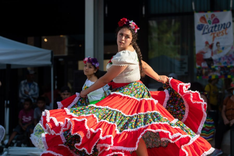 Dancers are seen dancing to music at the Latino Festival in Iowa City on Saturday, Aug. 28, 2021. (Rachel Wagner/The Daily Iowan)