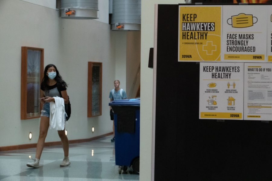 Two students are seen walking in the Seamans Center at the University of Iowa on Aug. 23, 2021. Per the state Board of Regents COVID-19 mask policy, students have the option to wear a mask.
