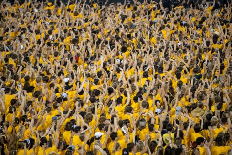 Iowa freshman students wave to the University of Iowa Stead Family Childrens Hospital during Kick Off at Kinnick at Kinnick Stadium on Friday, Aug. 19. (Jerod Ringwald/The Daily Iowan)