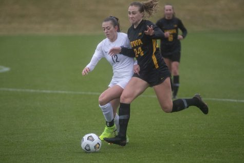 Iowa defender, Sara Wheaton, and Penn State midfielder, Payton Lineman, fight for the ball during the Iowa women's soccer match v. Penn State at the Iowa Soccer Complex on Thursday, March 25, 2021. The Nittany Lions defeated the Hawkeyes 1-0.