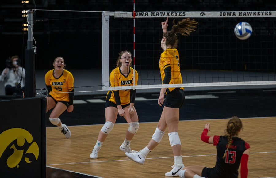 Iowa setter Bailey Ortega celebrates a point following a kill from outside hitter Courtney Buzzerio during a women's volleyball match between Iowa and Rutgers at Xtream Arena on Saturday, Feb. 20, 2021. The Scarlet Knights defeated the Hawkeyes 3 sets to 2. (Jerod Ringwald/The Daily Iowan)