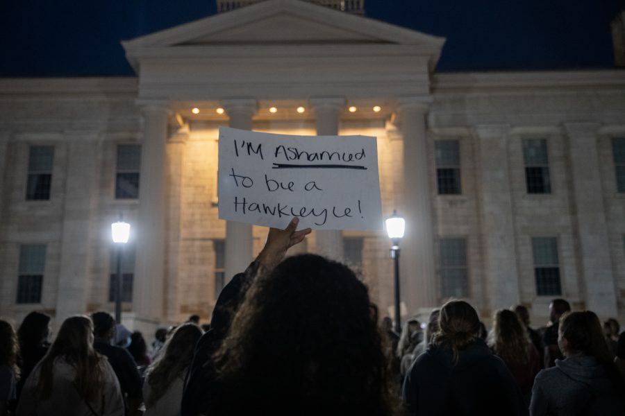 A+protester+holds+up+a+sign+saying+%E2%80%9CI%E2%80%99m+ashamed+to+be+a+Hawkeye%E2%80%9D+during+the+third+night+of+protests+following+sexual+assault+allegations+against+the+University+of+Iowa%E2%80%99s+chapter+of+Phi+Gamma+Delta+at+the+Pentacrest+on+Thursday%2C+Sept.+2%2C+2021.+