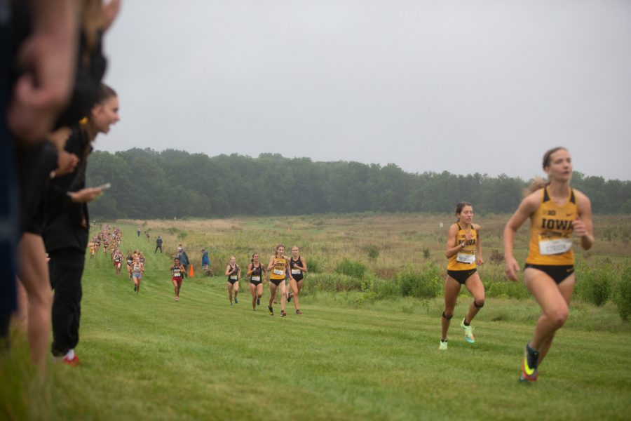 University of Iowa runner Miriam Sandeen climbs the hill toward the finish line behind teammates Lauren McMahon and Emma Gordon at the Ashton Cross Country Course on Friday, Sept. 3, 2021. Sandeen finished 22nd in the 4K with a time of 14:28.8.