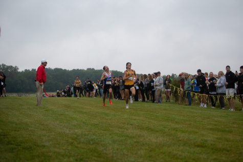 Iowa runner Nick Trattner races Drake's Enzo Marie at the Hawkeye Invite at the Ashton Cross Country Course on Friday, Sept. 3, 2021. Trattner and Marie finished second (18:22.1) and third (18:22.8), respectively.