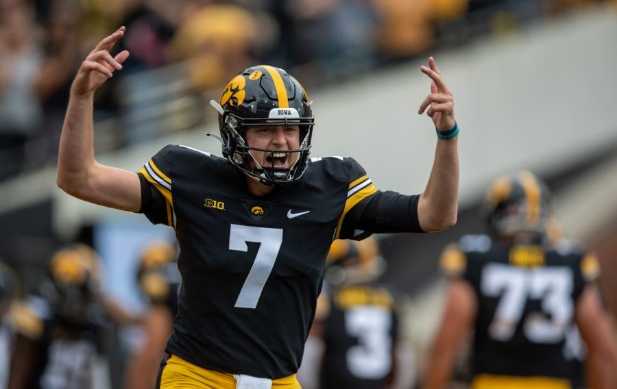 Iowa quarterback Spencer Petras celebrates a touchdown from running back Tyler Goodson during a football game between No. 18 Iowa and No. 17 Indiana at Kinnick Stadium on Saturday, Sept. 4, 2021. (Jerod Ringwald/The Daily Iowan)