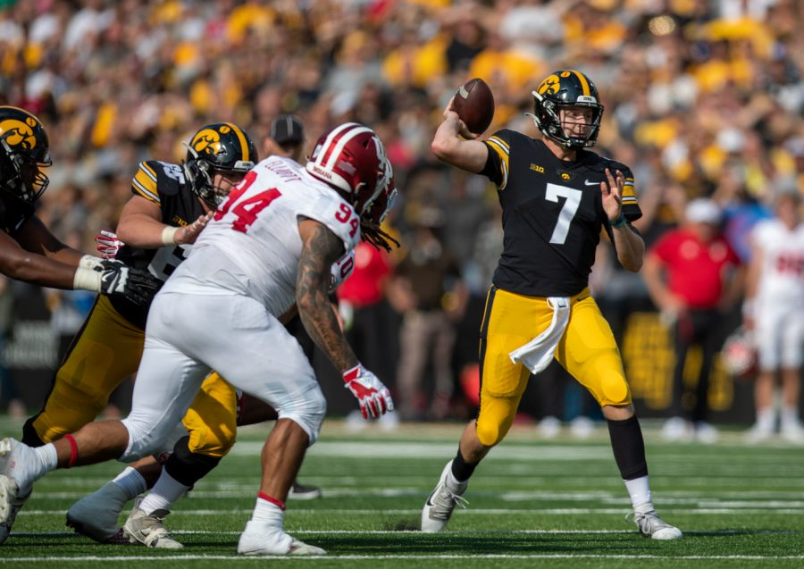 Iowa quarterback Spencer Petras winds up to throw during a football game between No. 18 Iowa and No. 17 Indiana at Kinnick Stadium on Saturday, Sept. 4, 2021. (Jerod Ringwald/The Daily Iowan)