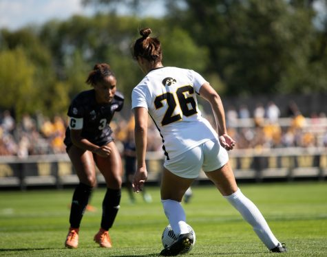 Iowa Forward Kenzie Roling looks to move past a Mississippi State defender at UI Soccer Complex on Sunday, Sept. 5, 2021. The Iowa Hawkeyes and Mississippi State Bulldogs tied 1-1.