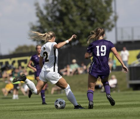 Hawkeye midfielder Hailer Ryderberg kicks the ball towards the middle of the field toward her teammates during a soccer match between Iowa and Northwestern at the University of Iowa Soccer Complex on Sunday, Sept. 19, 2021. The Hawkeyes defeated the Wildcats with a score of 2-1.