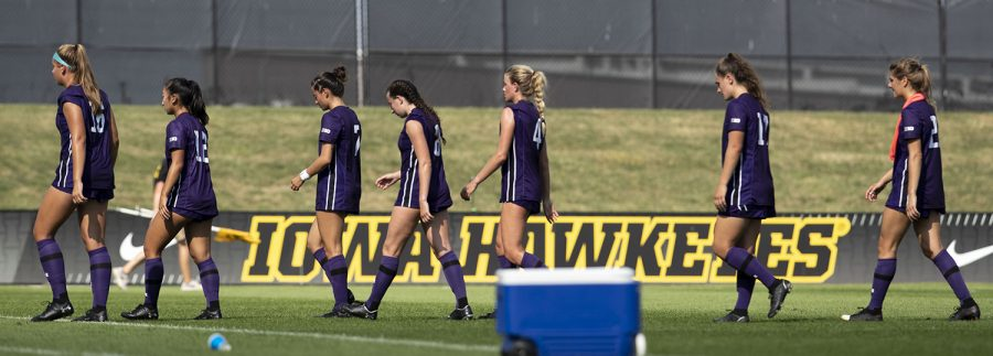 The Northwestern team walks toward their sideline after a soccer match between Iowa and Northwestern at the University of Iowa Soccer Complex on Sunday, Sept. 19, 2021. The Hawkeyes defeated the Wildcats with a score of 2-1.