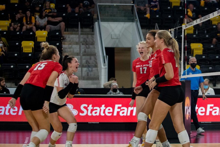 Ball State celebrates a point scored during the volleyball match between Iowa and Ball State on Friday, Sept 10, 2021. The Cardinals defeated the Hawkeyes 3-2.