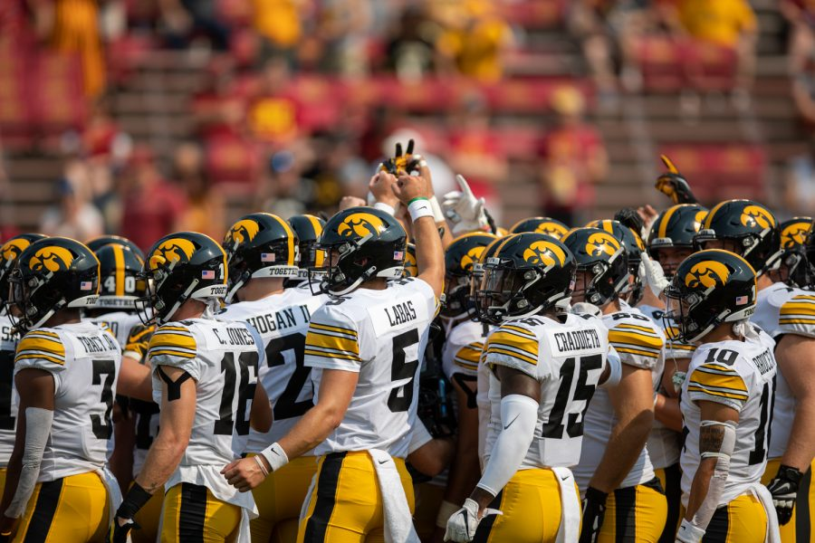 The Iowa Hawkeyes huddle up before a football game between No. 10 Iowa and No. 9 Iowa State at Jack Trice Stadium in Ames on Saturday, Sept. 11, 2021. (Jerod Ringwald/The Daily Iowan)