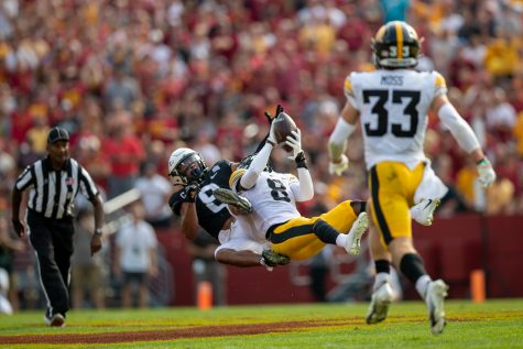 Iowa defensive back Matt Hankins intercepts a pass during a football game between No. 10 Iowa and No. 9 Iowa State at Jack Trice Stadium in Ames on Saturday, Sept. 11, 2021. (Jerod Ringwald/The Daily Iowan)