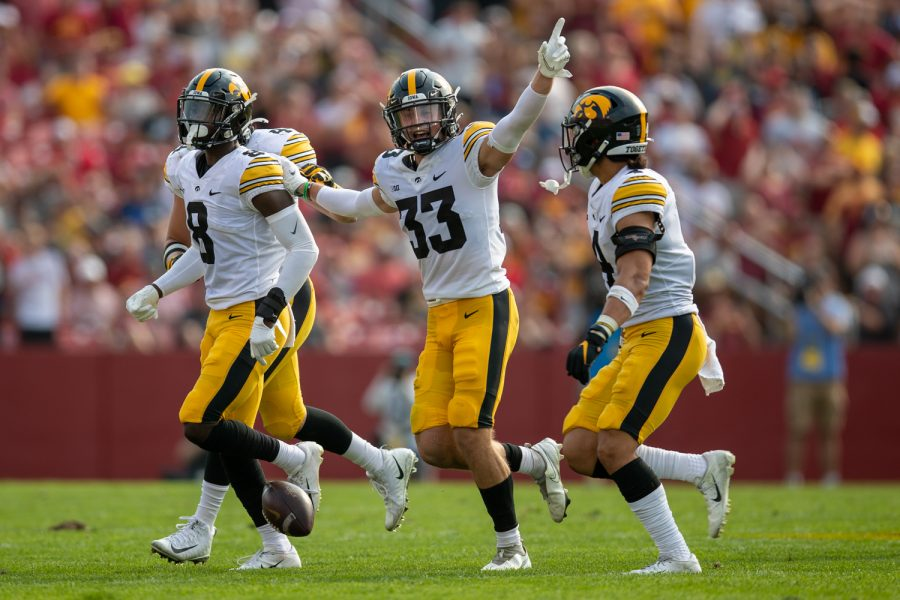 Iowa defensive back Riley Moss celebrates an interception from teammate Matt Hankins during a football game between No. 10 Iowa and No. 9 Iowa State at Jack Trice Stadium in Ames on Saturday, Sept. 11, 2021. (Jerod Ringwald/The Daily Iowan)